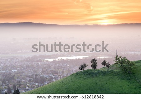 Shutterstock Breathtaking Silicon Valley Sunset. Santa Clara Valley in Haze with green hill and sunset skies from Mount Hamilton.