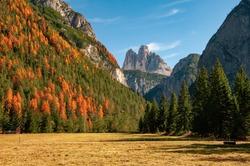 Breathtaking view of famous Tre Cime di Lavaredo (Drei Zinnen) from Landro Valley (Hohlensteintal) at sunny autumn day, Dolomite Alps, Italy. UNESCO World Heritage Site