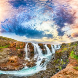 Breathtaking view of  Kolufossar waterfall at sunset.  Popular tourist travel destination in Iceland . Location: Kolufossar waterfall, Vestur-Hunavatnssysla, Iceland, Europe