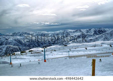 Shutterstock Breathtaking view of skiers and beautiful mountains at sunset in Valle Nevado