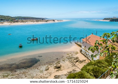 Breathtaking view of the mouth of the River Mira flowing into the Atlantic Ocean - Aquatic lifestyle sport in idyllic turquoise water, Vila Nova de Milfontes, Vicentine Coast Natural Park PORTUGAL Сток-фото ©