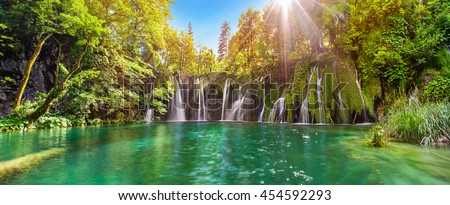 Shutterstock Breathtaking waterfalls panorama in Plitvice Lakes National Park, Croatia, Europe. Majestic view with turquoise water and sunset sunny beams, travel destinations background