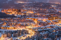 Breckenridge, Colorado, USA town skyline in winter at dusk.