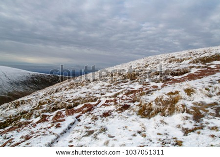 Brecon Beacons National Park - Crybyn mountainside with snow.  #1037051311