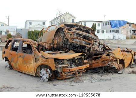 BREEZY POINT, NY - NOVEMBER 20: Burned cars in the aftermath of Hurricane Sandy on November 20, 2012 in Breezy Point, NY