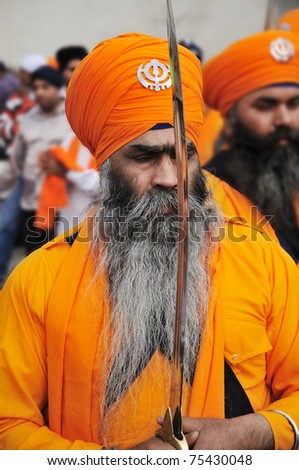 BRESCIA, ITALY - APRIL 16: Sikh devotees take part to Baisakhi procession 2011 on April 16, 2011 in Brescia - stock photo