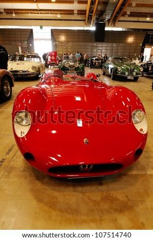 BRESCIA ITALY - MAY 16: Red Maserati Barchetta  veteran car, waits for scrutineering before 1000 Miglia historic car race in a fair hall, on May 16, 2012 in Brescia