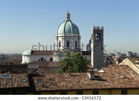 Brescia, Italy, the dome of the Cathedral and the Tower of Broletto - stock photo