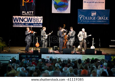 BREVARD, NC, USA - SEPTEMBER 11: The Steep Canyon Rangers perform with surprise guest, comedian Steve Martin, at the bluegrass Mountain Song Festival in Brevard, NC on Sept 11, 2010