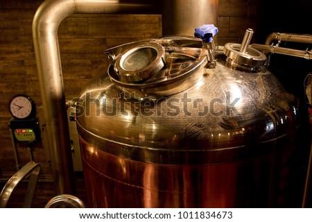Brewery kettle closeup. Indoor brewery in basement, closeup. #1011834673