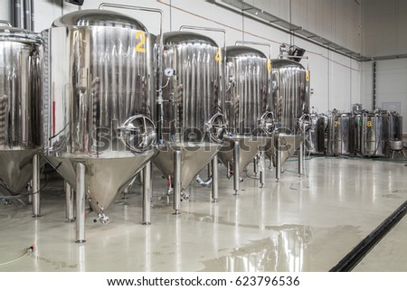 Brewery. Modern beer plant with brewering kettles, tubes and tanks made of stainless steel Stock photo ©