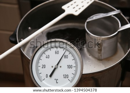 Brewing craft beer in a kitchen. Home brewing concept image.