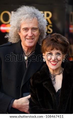 Brian May and Anita Dobson arrives for the Olivier Awards 2012 at the Royal Opera House, Covent Garden, London. 15/04/2012 Picture by: Simon Burchell / Featureflash