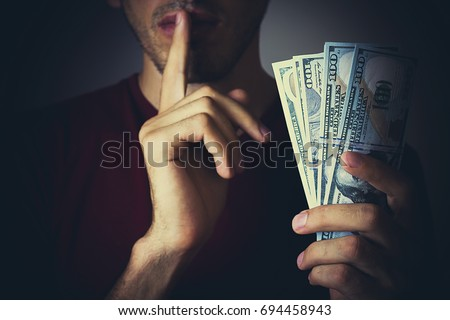 Bribery people with dollar bills in hand and quiet gesture Foto stock ©