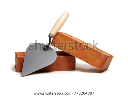 Brick and trowel on a white background