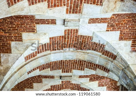 Brick background texture. Brick arch ceiling in Place des Vosges (Marais, Paris)