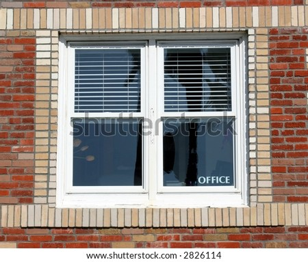Brick building with office window