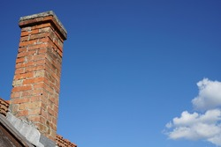 Brick chimney and the blue sky
