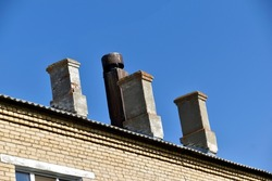 Brick chimneys on a large residential building