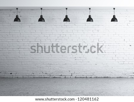 brick concrete room with five ceiling lamps - stock photo