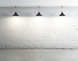 brick concrete room with three ceiling lamps