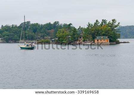 Brick cottage on stone small island #339169658