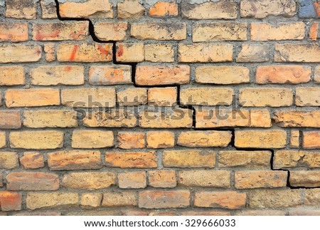 Brick foundation with a crack in the mortar