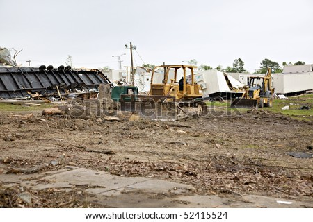 Brick High School one week after tornado damage - earthmoving equipment is shown on the grounds, along with destroyed mobile temporary classrooms.