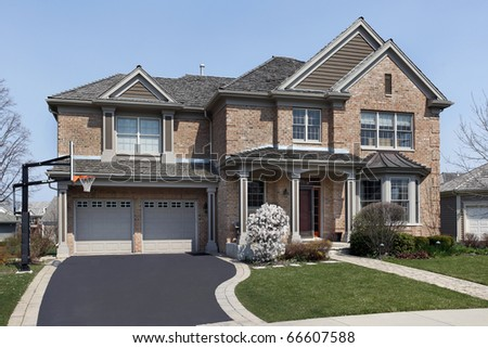 Brick home in suburbs with covered entry