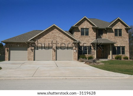 Brick home with attached garage stock photo 3119628 for Brick garages prices