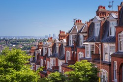 Brick houses of Muswell Hill and panorama of London with Canary Wharf - England, UK