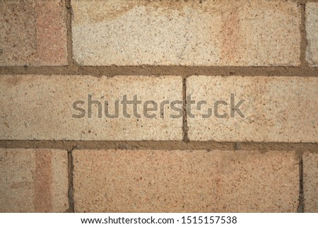 Brick laying. Solid material. Building material. An even row of bricks