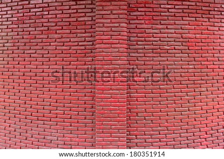 Brick paint with red color.Wall is vivid color and polished. Red wall in bow perspective.