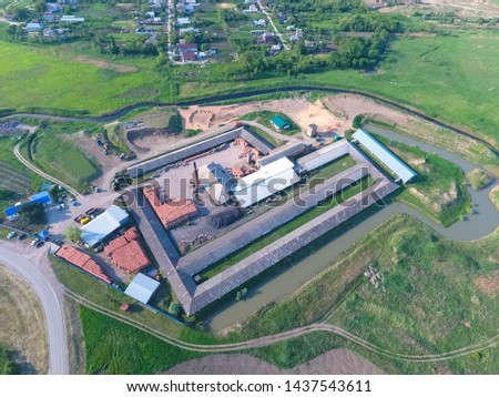 Brick production plant. Top view of a small factory for firing bricks. #1437543611