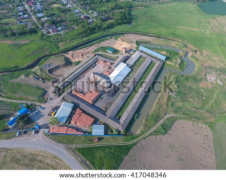 Brick production plant. Top view of a small factory for firing bricks. #417048346
