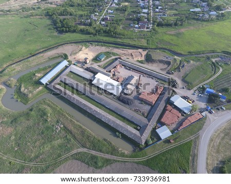 Brick production plant. Top view of a small factory for firing bricks. #733936981