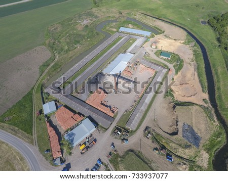 Brick production plant. Top view of a small factory for firing bricks. #733937077
