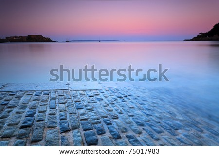 Brick road at a tranquil purple sunset