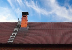 Brick roof chimney and a ladder
