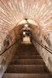 Brick stairs going into a cellar