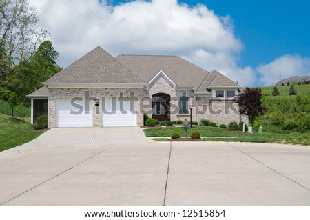 Brick Suburban Home in Summer