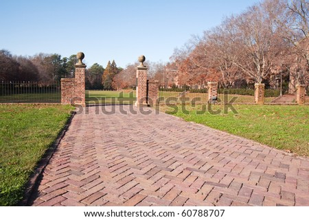 Brick walkway to the sunken gardens on the campus of the College of William and Mary in Virginia during autumn