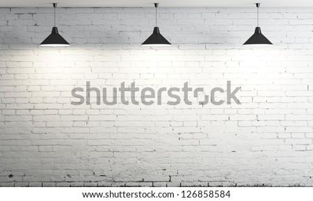 brick wall and three ceiling lamp