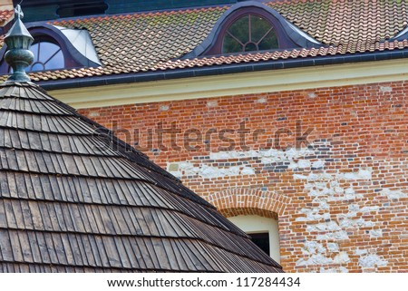 Brick wall and wooden roof of Benedictine monastery - Tyniec near Cracow, Poland