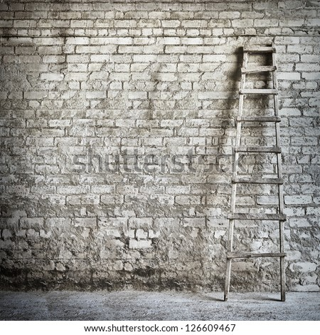 brick wall background ,  ladder near the wall