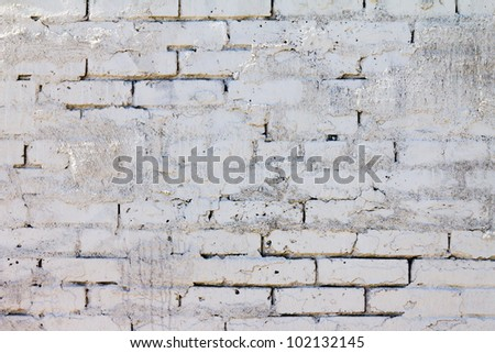Brick wall background pattern with old white paint texture
