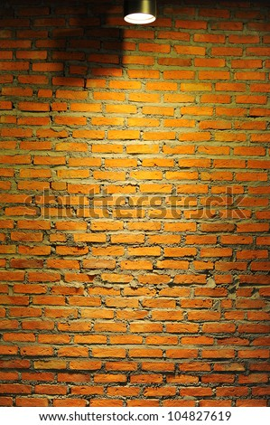 Brick wall background with light effect.