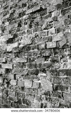 Brick wall black-and-white photo.