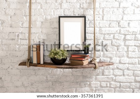 brick wall  drift wood shelves and frame concept decor