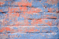 Brick wall in orange and purple peel off paint